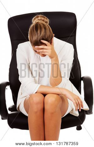 Depressed businesswoman sitting on armchair