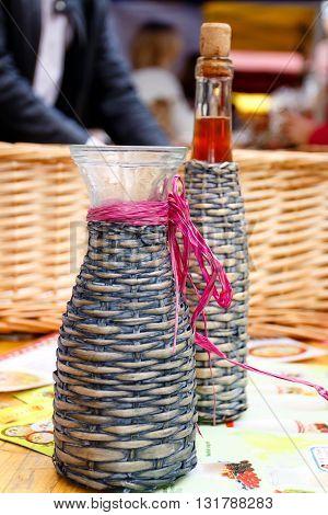 Close up of demijohn homemade wine on spring fair
