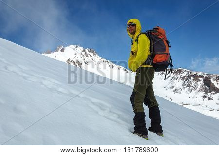 Male climber rises on a snowy volcano. Turkey