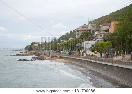 VUNG TAU, VIETNAM - DECEMBER 22, 2015: View of the embankment at the foot of the coastal mountains in the tourist town of Vung Tau