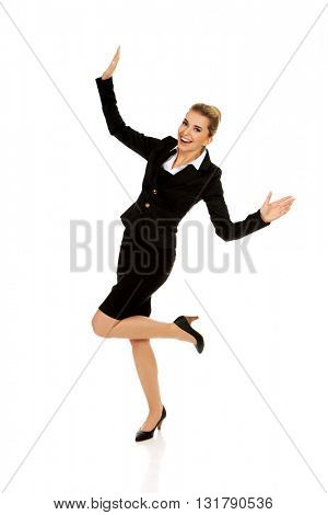 Young happy jumping businesswoman