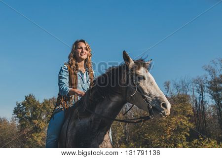 Pretty Girl Riding Her Grey Horse
