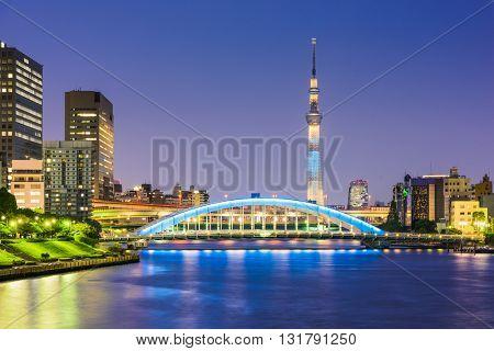 Tokyo, Japan skyline on the Sumida River at night.