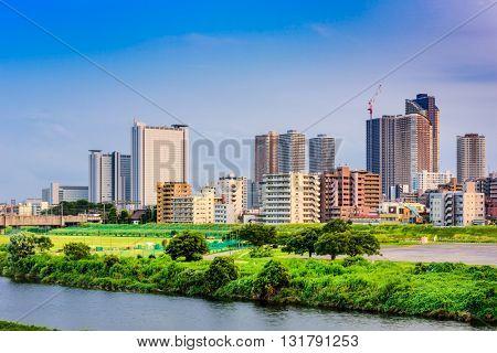 Kawasaki, Japan skyline on the Tamagawa River.