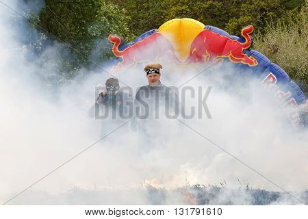 STOCKHOLM SWEDEN - MAY 14 2016: Men in black clothes jumping over fire and smoke in the obstacle race Tough Viking Event in Sweden April 14 2016