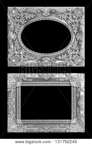 The antique silver frame on the black background