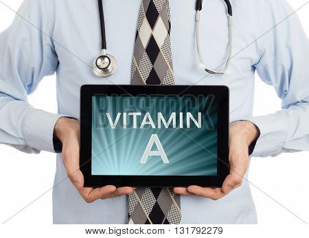 Doctor Holding Tablet - Vitamin A