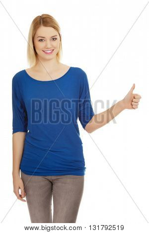 Young woman showing thumbs up.