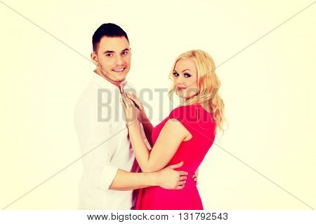 Young happy hugging smiling couple