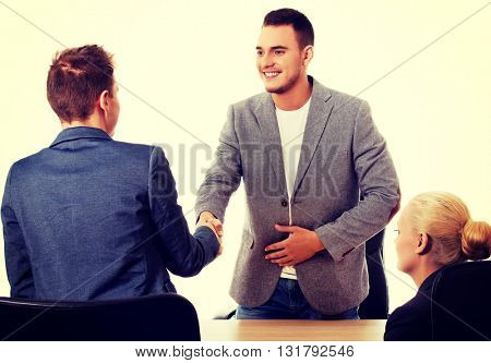 Business meeting-three people sitting and talking