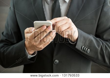 Businessman using mobile smartphone for conection businese