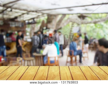 soft focus wooden table with blur coffee shop Background