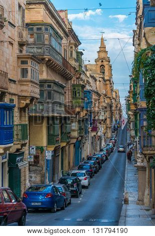 Valletta, Malta - December 25, 2015, View of the typical street of Valletta with varicolored balconies and historical buildings