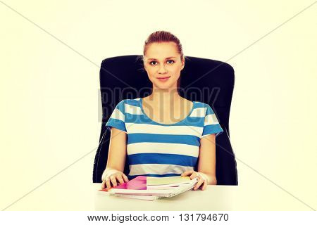 Teenage woman learning at the desk