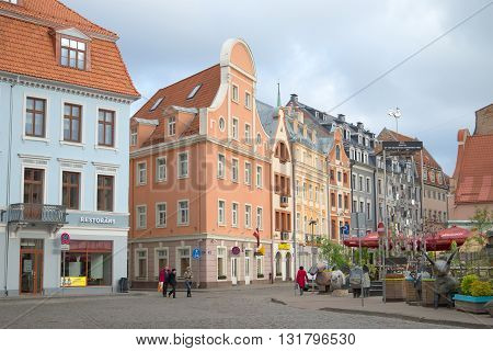 RIGA, LATVIA - MAY 02, 2014: An overcast day in May in the old Riga. People walk on a tourist part of Riga