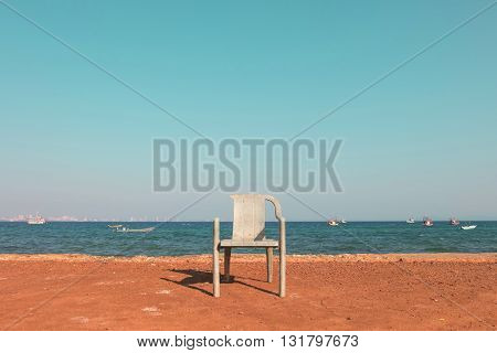 Chair in front of a nice and relax sea beach view.