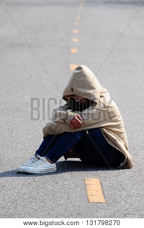 Woman alone in upset and depressed on the road