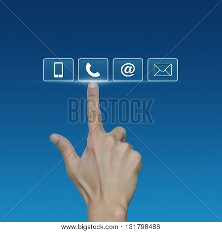 Hand pressing telephone mobile phone at and email buttons over blue background Customer support concept