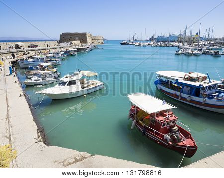 HERAKLION, CRETE - MAY 16: Fishing boats in the port of Heraklion in Crete at May 16, 2106