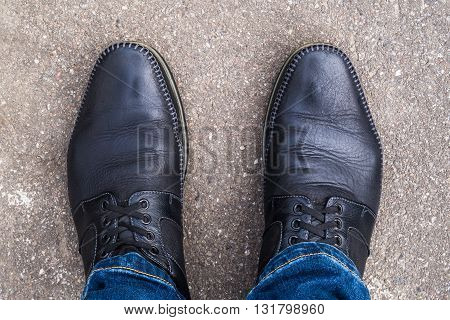 Black shoes on his feet close up