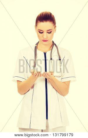 Female doctor holding something open palms