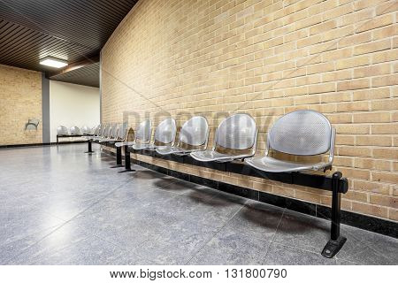 in an corridor there is a waiting room