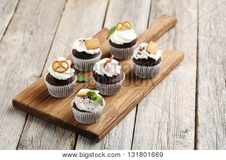Chocolate Cupcakes On A Grey Wooden Table