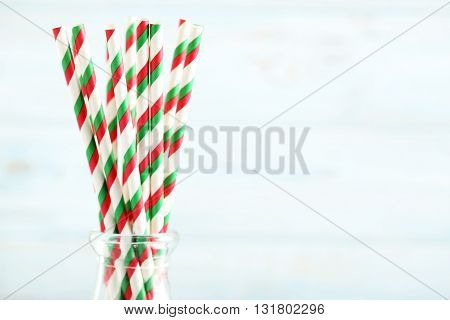 Striped Drink Straws On A Blue Wooden Background
