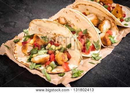 Photos of burrito time on rustic background