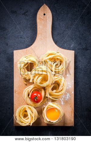 Photos of fettuccine pasta on rustic background