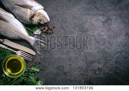 Fish head and tail on rustic background