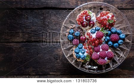 Photos of homemade mini tarts on rustic background