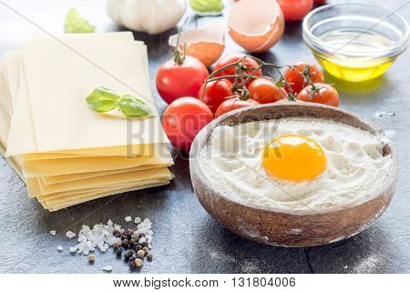 Photos of lasagna preparing on rustic background