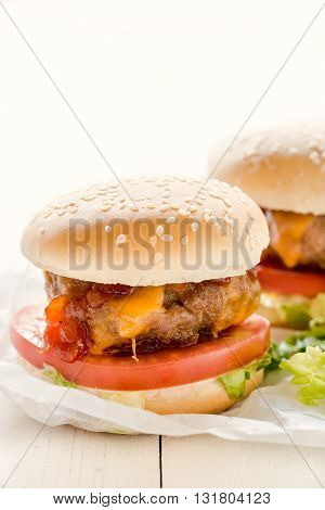 Photos of mini beef burgers on rustic background