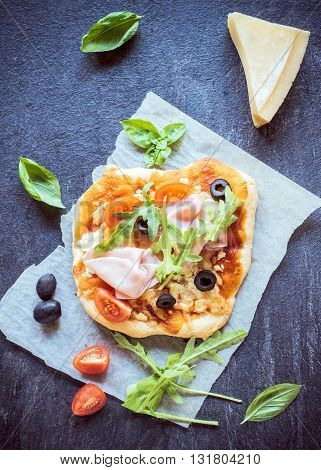 Photos of mini pizza on rustic background