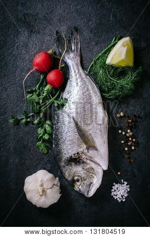 Photos of raw glithead fish on rustic background