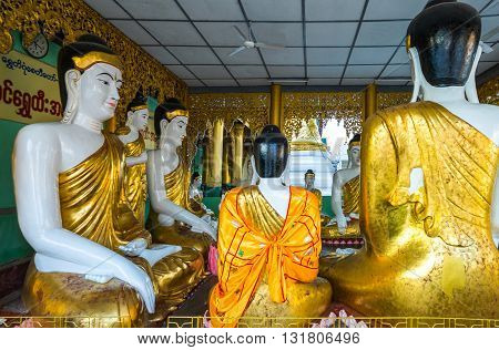 Yangon,  Myanmar - January 9, 2012:  Buddha statues in the Swedagon Pagoda.
