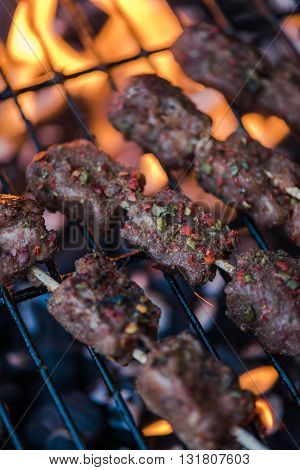 Beef Skewers Grilling On Flames From Charcoal Bbq