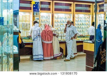 Dubai U.A.E. - February 17 2007: People of different ethnic groups making purchases in the famous Gold Souk