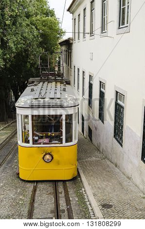 Famous vintage yellow tramway in Lisbon, Portugal