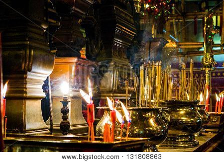 Hong Kong, China - September 23,  2007:  Candles and votive pots in the Man Mo temple near Hollywood road