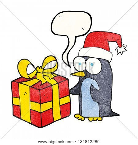 freehand drawn texture speech bubble cartoon christmas penguin with present