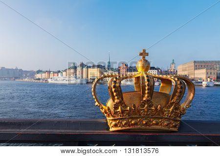 Royal golden crown and Stockholm cityscape at morning, Sweden