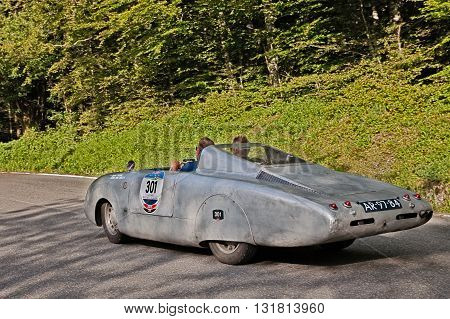 PASSO DELLA FUTA (FI) ITALY - MAY 21: driver and co-driver on a vintage competition car Autobleu 750 MM (1954) travel in Tuscany during the historic race Mille Miglia on May 21, 2016 in Passo della Futa (FI) Italy