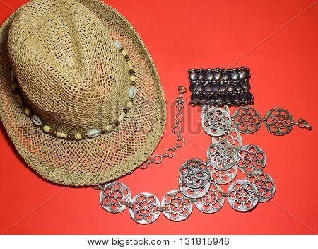 The stylish summer beach accessories. Vacation mood. Straw hat, belt and a bracelet.