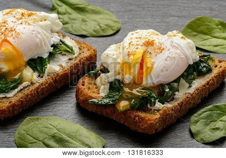 Healthy breakfast - sandwich with creme cheese, spinach and poached egg.