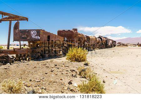 Vintage rusty old steam train in the Uyuni desert Bolivia