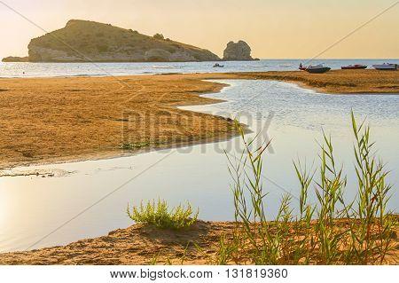 Summertime. Gargano coast: Portonuovo beach,Vieste-(Apulia) ITALY-In the background the Gattarella island.
