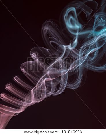 Abstract smoke of different colors on a black background