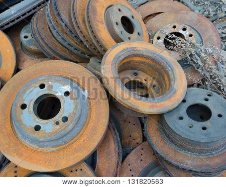 Useless worn out rusty brake discs and other parts